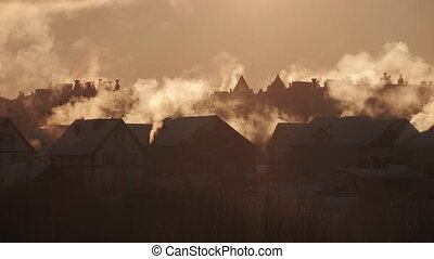 Smog from chimneys on the residential houses in a village ...