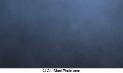 Smoke abstract. Smoke cloud. Smoke on black background in blue light. Smoke effect.