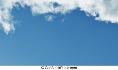 smoke against blue cloud sky