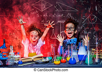 smoke and shock - Funny little children doing experiments in...