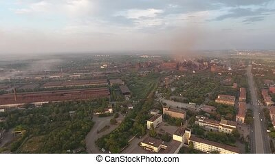 Smoke and smog over the plant and the city. Aerial view. -...