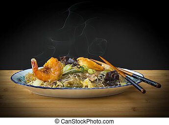 Smoke asia glass noodles, prawn and vegetables on bamboo...