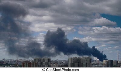 Big fire at building. - Smoke at sky over city. Big fire at...