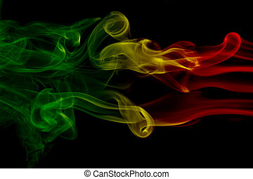 Smoke background reggae colors green, yellow, red colored in...