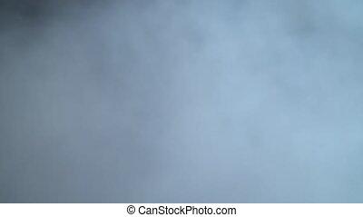 Smoke billowing on black background - Smoke billowing over...