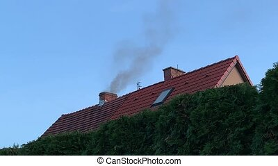 Smoke comes from chimney - Smoke comes from the chimney of...