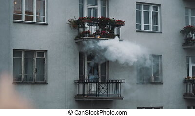 Smoke coming out of the appartment on fire. . High quality 4k footage