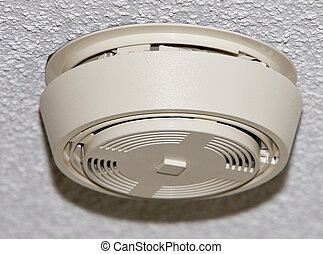 Smoke detector mounted on stippled ceiling