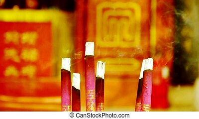 Smoke-filled burning incense, In temple.