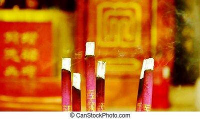 Smoke-filled burning incense