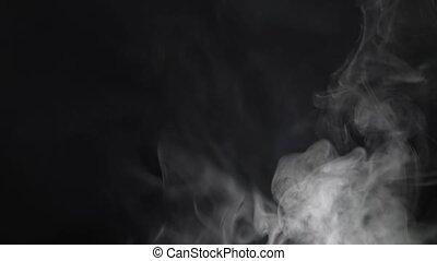 Smoke fills the screen on a black background - White smoke...