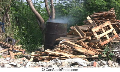 Smoke From A Burning Barrel - A barrel belches out smoke as...