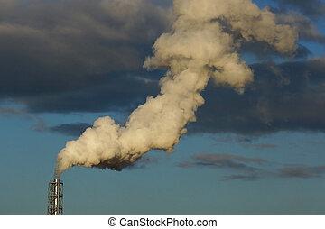 smoke from a chimney on a blue sky