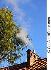 Smoke from a chimney sky blue