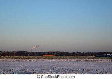 smoke from a chimney - winter
