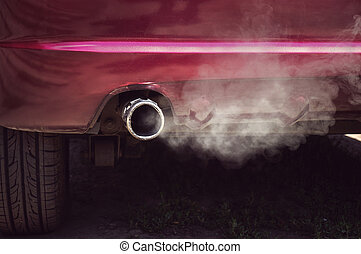 Smoke from car pipe exhaust. old dirty red car
