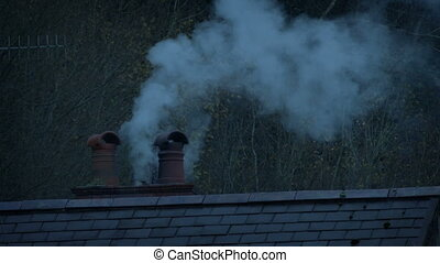 Smoke From Chimney In The Evening - Smoking chimney on roof ...