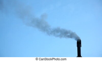 Smoke from chimney - Smoke coming out from a black chimney