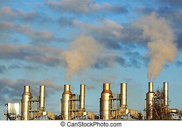 smoke from chimneys on a blue sky