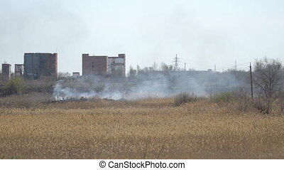 Smoke from fire in front of factory buildings - Smoke from a...