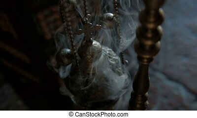 Smoke from incense and cross in Catholic church indoors....