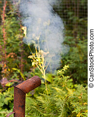 smoke from rusty chimney