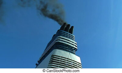 Smoke from ship funnel on a blue sky