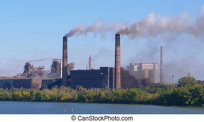 Smoke from the Chimneys of Industrial Metallurgical Plant Rises in the Atmosphere near the City