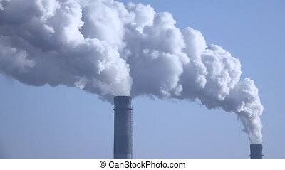 Smoke from the chimneys plant rises into the clouds 004 -...