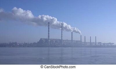 Smoke from the chimneys plant rises into the clouds 005 -...