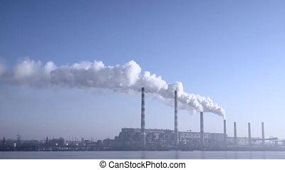Smoke from the chimneys plant rises into the clouds - Smoke...