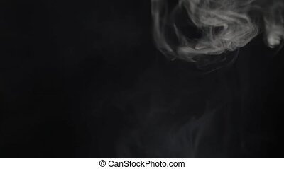 Smoke from top on black background