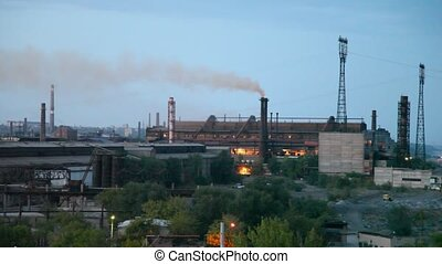 Smoke goes from factory pipes.