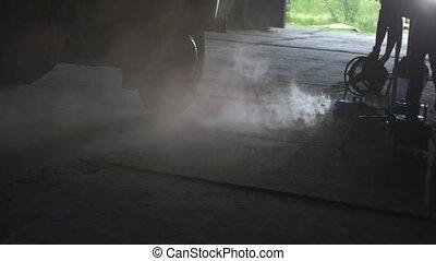 Smoke machines and fan work in the hangar and wheel machine
