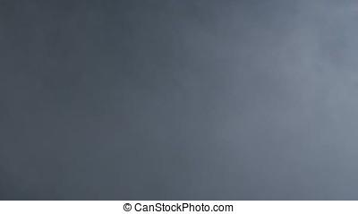 Smoke on black background. Abstract white powder explosion...