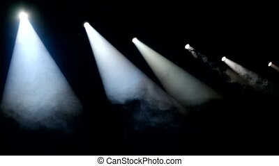 Smoke on the stage in the lights