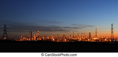 Smoke over Oil Refinery at twilight