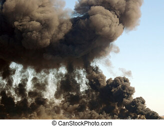 rising smoke plme from an explosion