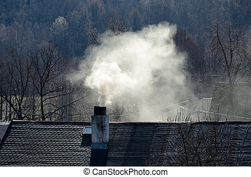 Smoke rising from a chimney