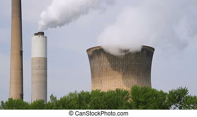 Smoke Stack and Cooling Tower Loop - Smoke and steam billow...