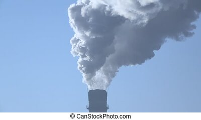 Close up smoke stack over blue sky background.