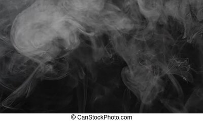 Smoke texture over blank black background. Mystical steam at...