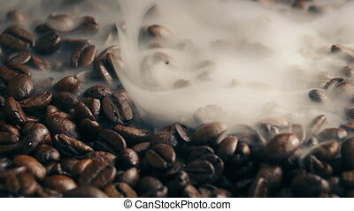Smoke Wafting Over Roasted Coffee Beans - Artistic shot of...