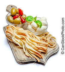 Smoked and Italian mozzarella cheese, olives, pepper on wooden cutting board