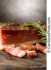 Smoked Bacon - photo of delicious smoked ham on wooden table...