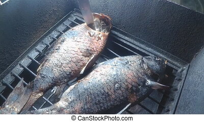 smoked carp in the smoke house. smoke from the fire and...