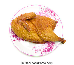 smoked chicken on a plate on a white background closeup
