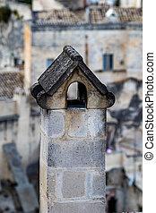 Smoked chimney close-up, street view, Matera, Italy