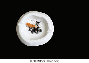 smoked cigarette in white ashtray