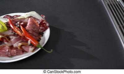 Smoked cold cuts on a plate - Dish with meat and sausage...